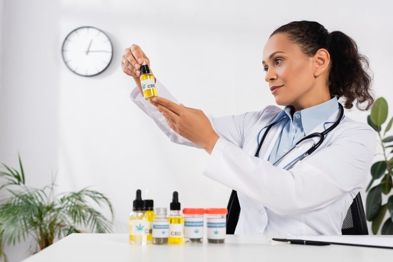 Doctor looking at CBD Oil